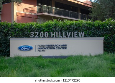 Palo Alto, California, USA - October 26, 2018: Ford Research and Innovation Center sign and logo on the green grass near research facility in Silicon Valley