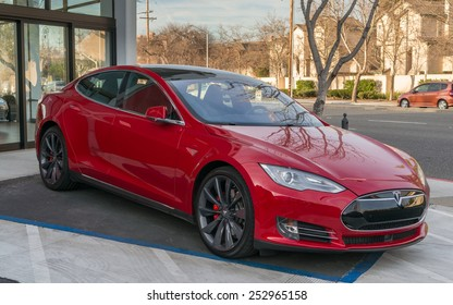 PALO ALTO, CA/USA - FEBRUARY 15: Tesla Model S on display on Feb 15, 2015 in Palo Alto, CA. It is an American company that designs, manufactures, and sells electric cars.
