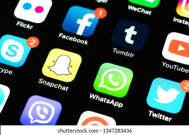 Palo Alto / USA - March 22, 2019: Apple iPhone X with icons of social media facebook, instagram, twitter, snapchat, telegram and other application on black screen. Social media icons. Social network