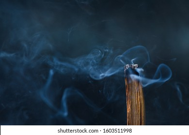 Palo Santo, holy sacred tree stick, burning with aroma smoke.