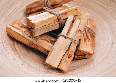 Palo Santo tree sticks in wooden bowl - holy incense tree from Latin America. Meditation, mental health and personal fulfilment concept, selective focus - Shutterstock ID 1936035715