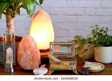 "Palo santo wood  which also known as ""holy wood"" or ""wood of the saints"" in a jewelry box near to the white sage, crystal quartz and salt lamps.  Concept of eliminating negative energy from home."