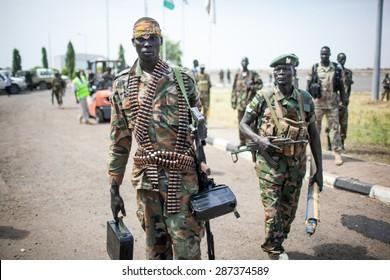 Paloch, South Sudan - March 2, 2014: A South Sudanese soldier carries a machine gun
