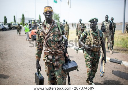 Paloch, South Sudan - March 2, 2014: A South Sudanese soldier carries a machine gun