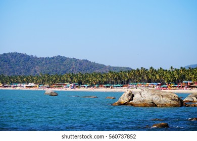 Palolem beach, South Goa, India. One of the best beaches in Goa. Colorful beach huts and palm trees on the coast.