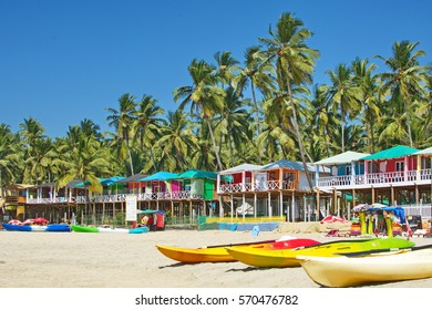 Palolem beach Southern Goa, India colorful sea front bungalows landscape
