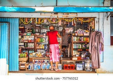 Palolem Goa India 10-28-2017  Man standing front a shop, beach road of Palolem in the evening