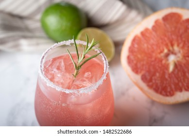 paloma cocktail with grapefruite on marble background
