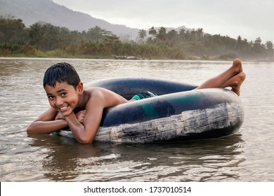 Palomino - Colombia, 18. January  2020: Little boy enjoys river tubing in Palomino, Colombia.