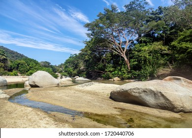 Palomino - Colombia, 20. January 2020: Nice stones in the Quebrada Concha river next to Tayrona National Park between Palomino und Santa Marta, Colombia