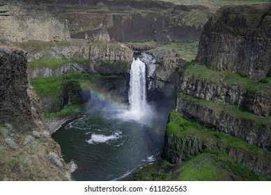 The Palouse falls in spring creating a rainbow along the way