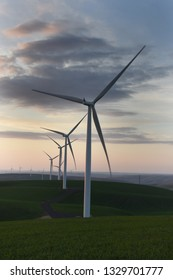 Palouse Wind Farm at sunset. This 105 megawatt farm came online in 2012. 58 wind turbines brought renewable energy to Whitman County, Washington