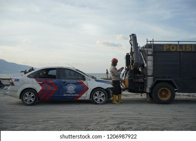 Palu, 7 october 2018 the police were towing an official car that was hit by a tsunami in the coast of talise Palu