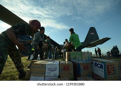 PALU Central Sulawesi, INDONESIA - OCTOBER 8, 2018: Indonesian volunteers and soldiers worked together to distribute humanitarian aid to victims of the earthquake and tsunami disaster in Palu, Central
