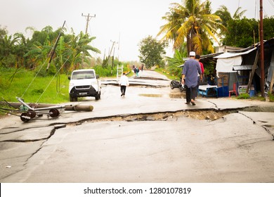 Palu, Indonesia 12 October 2018: People walking on the liquefaction affected roads of Petobo district in Palu.