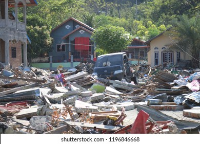 PALU, INDONESIA - OCTOBER 6 2018: The condition of damaged houses in Palu after a week after the earthquake and tsunami disaster. Residents' houses were destroyed and fell apart in Palu City