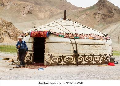 PAMIR, TAJIKISTAN - JULY 24: Tajik traditional yurt in Pamir mountains, Tajikistan on July 24, 2015. Pamir highway is part of a famous silk road.