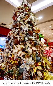 PAMPANGA , PHILIPINES - 26 OCTOBER 2018: Christmas trees decorated with colorful ornaments indoor isolated