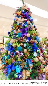 PAMPANGA, PHILIPINES: 26 OCTOBER 2018: Christmas trees decorated with colorful ornaments indoor isolated