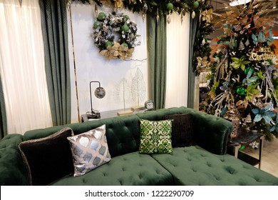 PAMPANGA, PHILIPINES: 26 OCTOBER 2018: Sitting corner with classic green sofa and decorative pillows and golden and silver festive season ornaments around
