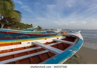 PAMPATAR, VENEZUELA, APRIL 17: Colorful wooden fisher boats anchored in the bay of Pampatar with loads on the wooden pier. Margarita Island. Venezuela 2015