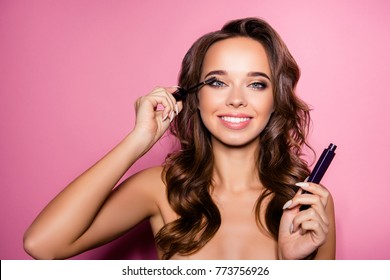 Pampering, healthcare perfection concept. Attractive nude gorgeous charming lady with ideal face, healthy shiny clear skin, amazing hairstyle, has tube of mascara in arm