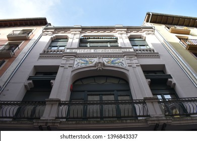 PAMPLONA, NAVARRE, SPAIN - APRIL, 19TH, 2019: Perspective of the modernist façade of the Traditionalist Society of Pamplona (Sociedad Tradicionalista de Pamplona)