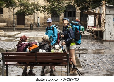 PAMPLONA, NAVARRE, Spain - July 7th 2014: Pilgrims rest  in the Plaza de los Ajos before taking the way to St James