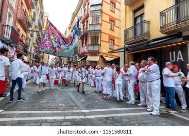 PAMPLONA, SPAIN - JUL 11: San Fermin festival revelers crowd the Estafeta corridor on July 11, 2018. Estafeta is a straightaway for the running of the bulls before entering the stadium.