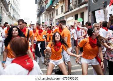 PAMPLONA, SPAIN - JULY 09, 2017: Unidentified people in a popular batucada by the streets of Pamplona in the celebrations of San Fermin. Fun is on the street
