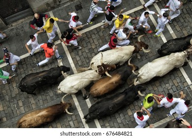 PAMPLONA, SPAIN - JULY 10, 2017: Bulls and people are running in Estafeta street  during San Fermin festival, Pamplona Fiesta