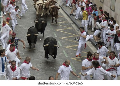 PAMPLONA, SPAIN - JULY 11, 2017: Bulls and people are running in Santo domingo street  during San Fermin festival, Pamplona Fiesta