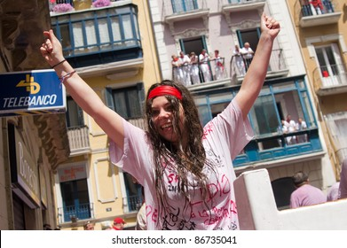PAMPLONA, SPAIN -JULY 6: Girl having fun at the opening of the San Fermin festival. Pamplona, Navarra, Spain 6 July 2011 in Pamplona Spain.