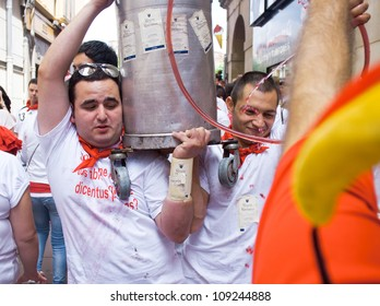 PAMPLONA, SPAIN -JULY 6: Young people having fun at the opening of the San Fermin festival in plaza Castilio. Pamplona, Navarra, Spain 6 July 2012 in Pamplona.