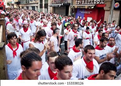 PAMPLONA, SPAIN - JULY 8: People await start of race of bulls at San Fermin festival. Pamplona, Navarra, Spain July 8, 2013.