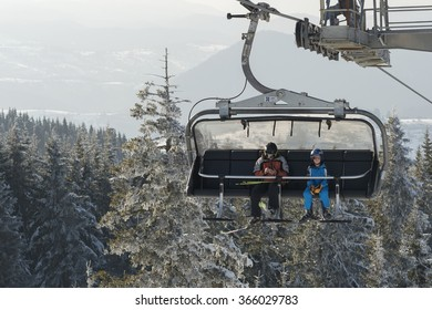 Pamporovo, Bulgaria - March 03, 2013: a lift and tourists in winter Ski resort Pamporovo. Pamporovo is a popular ski resort in Smolyan Province, southern Bulgaria.