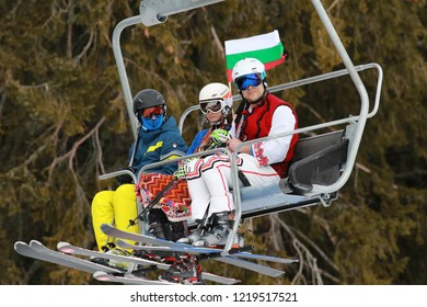 Pamporovo, Bulgaria - March 03, 2018 - Skiing with Bulgarian flags at Pamporovo ski resort, Bulgaria. People dressed with traditional Bulgarian clothes skiing with the Bulgarian national flag.