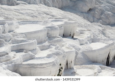"""Pamukkale meaning """"cotton castle"""" in Turkish, Pamukkale is a natural site in Denizli in southwestern Turkey. The area is famous for a carbonate mineral left by the flowing water."""