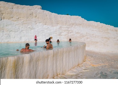Pamukkale Turkey July 2018, people bathing in Natural travertine pools and terraces in Pamukkale. Cotton castle in southwestern Turkey