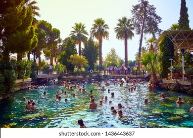PAMUKKALE, TURKEY - September 17, 2017: Unidentified tourists swim in the Antique pool (Cleopatra's Bath) in Pamukkale. It's a popular touristic destination during a Pamukkale visit