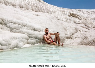 Pamukkale. Turkey.June 7, 2018.Man posing near the thermal springs and travertines of Pamukkale