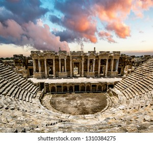 Pamukkale. Turkey.June 7, 2018.View of the ruins and amphitheater of the ancient city of Hierapolis at sunset.