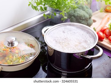 pan of boiling water with spaghetti on the cooker in the kitchen
