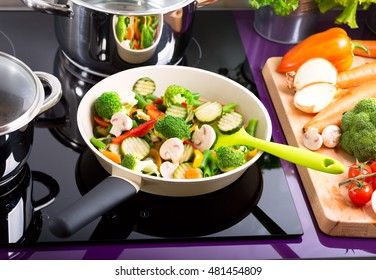 pan of chopped vegetables on the cooker in the kitchen