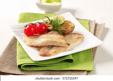 Pan fried fish fillets with roasted potato