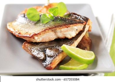 Pan fried fish fillets and vegetable garnish
