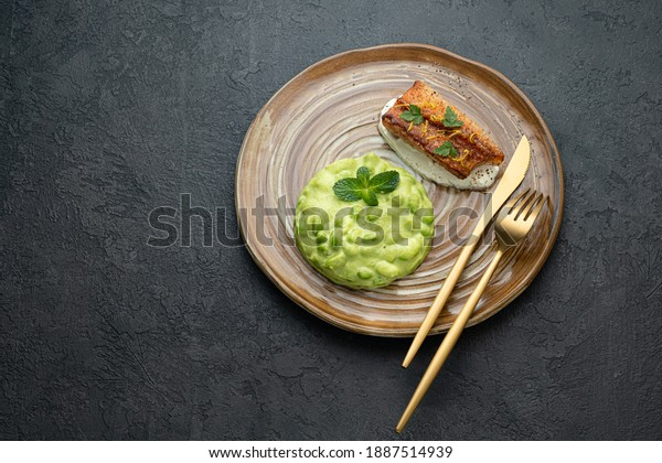 Pan fried ocean perch with snow peas puree and adamame, copy space