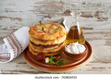 Pan fried potato tortillas served with yogurt sauce and fresh vegetables.