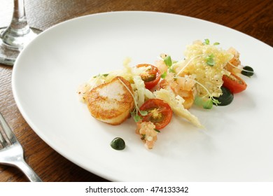 pan fried scallop shellfish appetizer plated meal