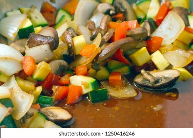 A pan full of juicy, delicious freshly sauteed organic vegetables